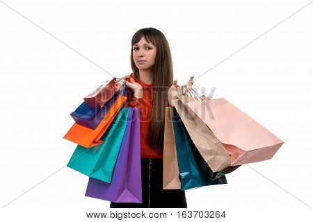 Young Long-haired Woman Holds Shopping Purchases, Many Colorful Paper Bags