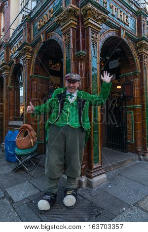 Dublin, Ireland - 2 Jan 2017: Temple Bar historic district., Dublin, Ireland. Man in Irish traditional clothes performing on the street at The Quays Bar