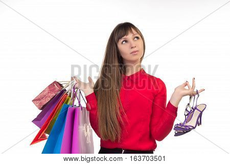 Young Long-haired Woman Holds Shopping Purchases, Multicoloured Paper Bags, Shoes