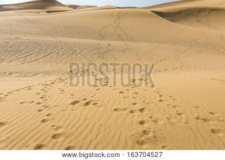 footsteps on sand dune of Maranjab Desert in Iran