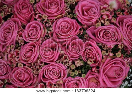 Mixed pink roses in a floral wedding decoration