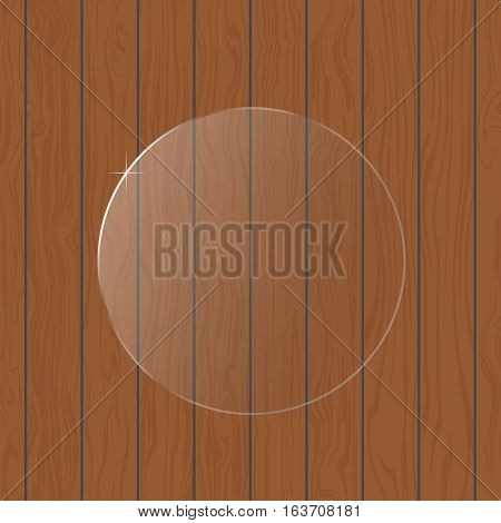 Round glass on a wooden background .
