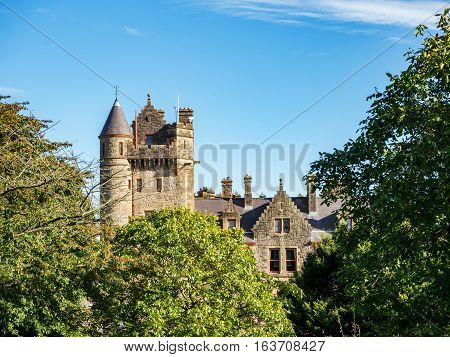 Belfast castle among trees. Tourist attraction on the slopes of Cavehill Country Park in Belfast Northern Ireland