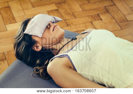 Savasana or corpse position in Yoga, toned image