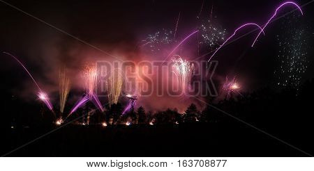 Fireworks With Pink And Purple Sparks And Lights