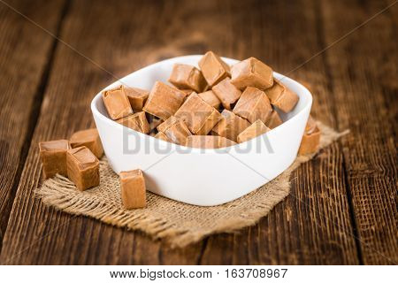 Wooden Table With Caramel (selective Focus)
