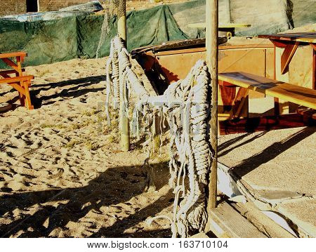 old fishing net hanging on a wooden fence, selective focus