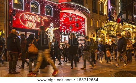 ParisFrance - 27 November 2016: Crowd of people walking in front of Sephora Shop on the famous Champs Elysees Boulevard during the winter holidays season.