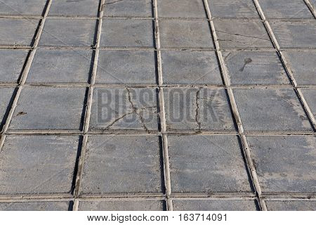 concrete tile for outdoor use Sidewalks, non-slip and wear resistance paving with tile Dirty and broken hydraulic tiles, perspective view