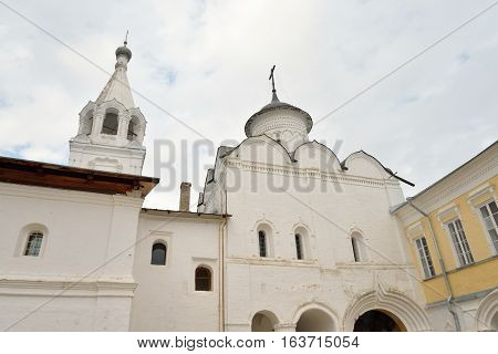 Church of the Ascension and bell tower of Saviour Priluki Monastery by cloud day near Vologda Russia.