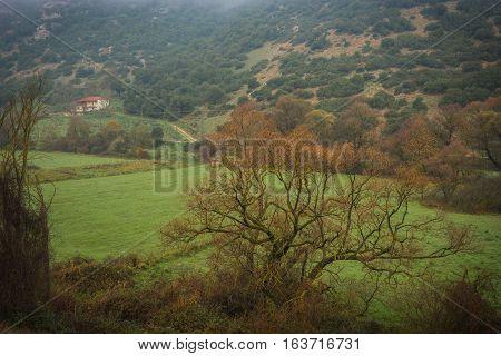 Scenic Foggy Autumn Landscape In Vouraikos Gorge Near Railway, Greece