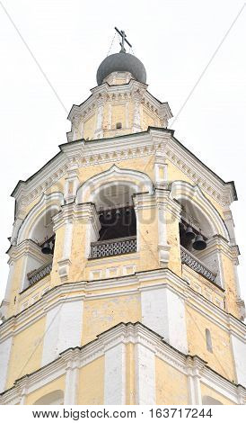 The new bell tower with the church Alexy in Saviour Priluki Monastery by cloud day near Vologda Russia.