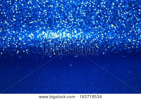 Defocused Abstract Blue Glitter With Bokeh Background