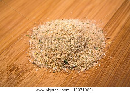 Seasoned Italian Bread Crumbs Isolated On A Wood Background