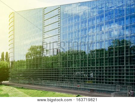 East glass facade of the European Parliament building in Strasbourg France on a sunny day. The European Parliament is the directly elected parliamentary institution of the European Union (EU). Together with the Council of the European Union (the Council)