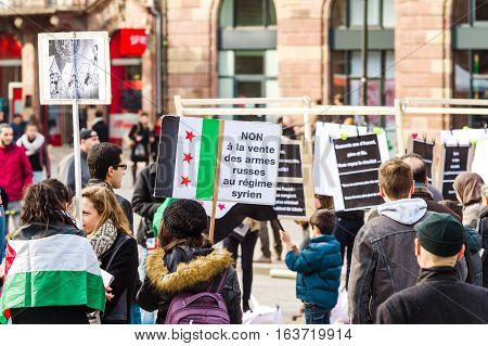 STRASBOURG FRANCE MAR 19 2016: No to Russian weapons being sell to Syrian regime - placard at the anti Bashar Al Assad demonstration