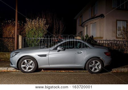 Beautiful Mercedes-benz Slk Roadster Car Parked In Night City