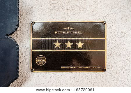 FREUDENSTADT GERMANY - NOV 20 2016: Hotelstars.eu - Hotel star rankings on three star German hotel facade - five star for luxury four stars for first class three stars for comfort two stars for standart and one star for tourist deutsche hotelklassificazie
