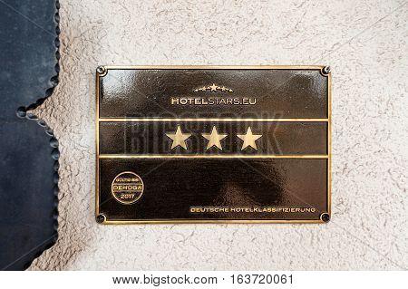 FREUDENSTADT GERMANY - NOV 20 2016: Hotelstars.eu - Hotel star rankings on three star German hotel facade - five star for luxury four stars for first class three stars for comfort two stars for standart and one star for tourist deutsche hotelklassificazie