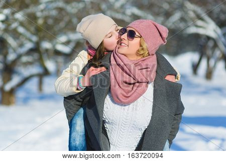 Happy family. Mother and daughter on a winter walk in nature.