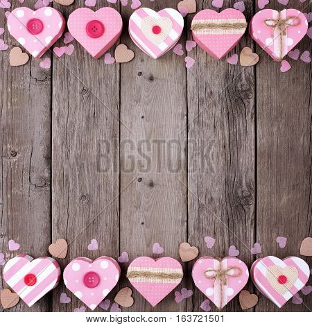 Valentines Day Double Border Of Heart Shaped Gift Boxes With Soft Pink And Burlap Trim Over Wood