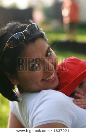 Woman Outside With Sunglasses And Baby