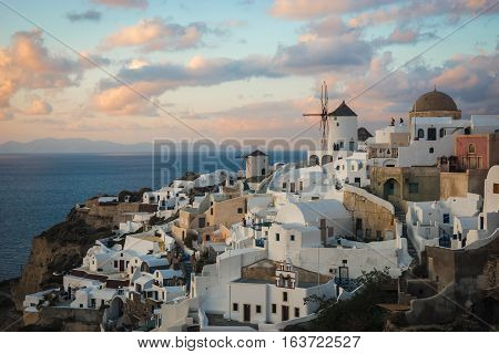 White City On A Slope Of A Hill At Sunset, Oia, Santorini, Greece