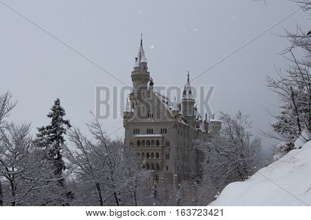 Fussen Germany - December 26 2014: view of the Neuschwanstein Castle in winter time on December 26 2014 near Fussen Germany.