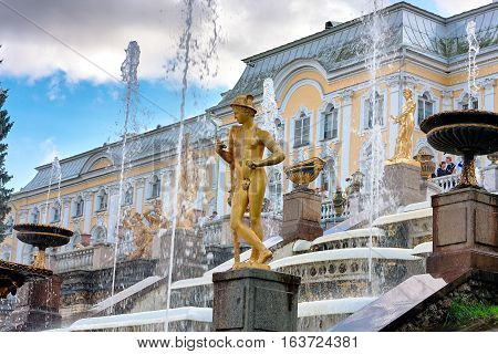 Peterhof, Saint-Petersburg, Russia - August 15, 2008: View of the Grand Peterhof Palace, with fountains and golden statues. Located on the southern shore of the Gulf of Finland.