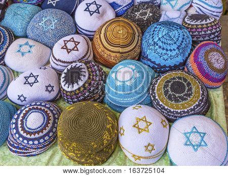 Kippahs Yarmulkes Jewish Hats Covers Israeli Star of David Souvenirs Safed Tsefat Israel. Kippahs/Yarmulkes are Jewish headgear worn by men during a Jewish. Required by Judaisim.