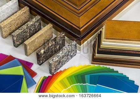 Planning home renovation. Home renovation material selection. Interior home renovation with doors counter and paint color samples. Home renovation.