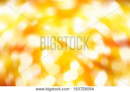 white bokeh blur on yellow background / Circle light on gold background / abstract light background