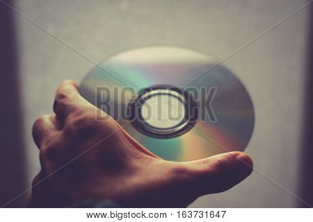 Human Hand Holding A Cpmpact Disk