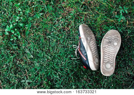 shoes on grass floor sleep relax feeling in holiday