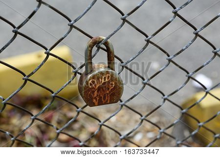 Engraved padlock on a fence in New York City