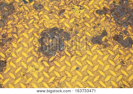 Rusted yellow grate in New York City