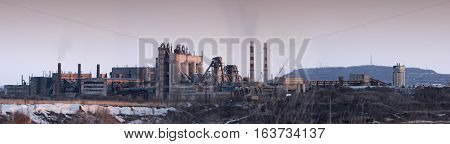 Cement factory tower. Panoramic image - Heavy industry.