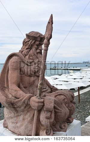 SOCHI RUSSIA SEPTEMBER 29 2016: View of the sculpture of Neptune on the beach background in the Sochi Russia