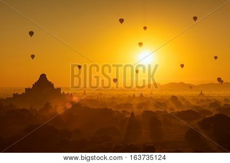Beautiful sunrise and hot air balloons over ancient pagoda in Bagan is old kingdom in past Myanmar