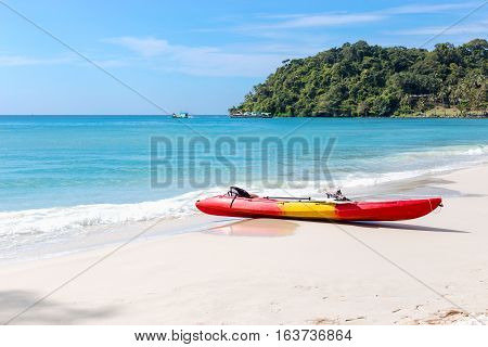 kayaks on the tropical beach with beautiful sky