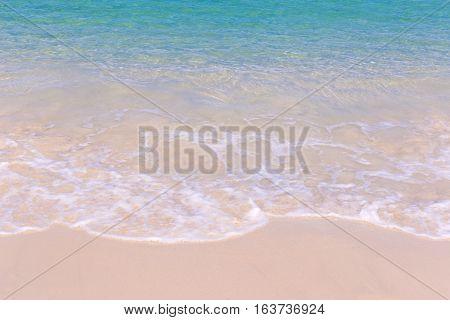 Soft wave of blue ocean sand beach.