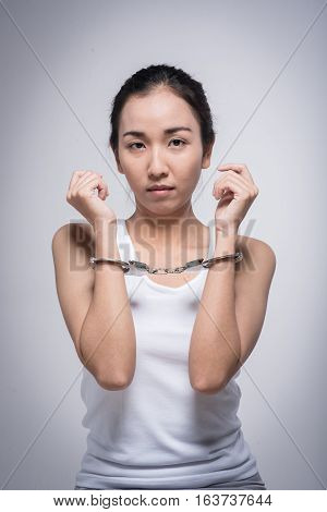 Sad woman with handcuffs.Stop Violence and abuse with woman concept.