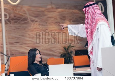 Woman office worker gets fired by arab businessman.