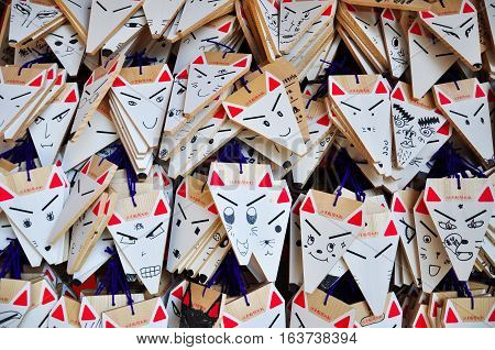 Kyoto Japan - March 31 2011: Fox Shape Ema (small wooden wishing plaques) at Fushimi Inari shrine Kyoto Japan.