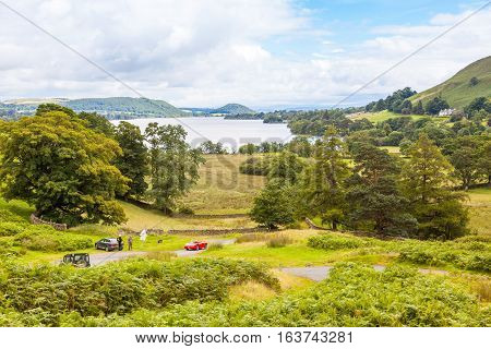 LAKE DISTRICT, UK - JULY 30 2012: An English Lake District country road with Ullswater in the background.