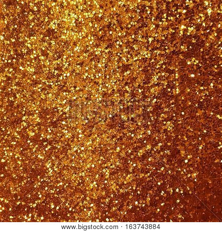Shiny gold glitter texture background for design