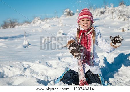 Happy Little Girl Playing  On Winter Snow Day.