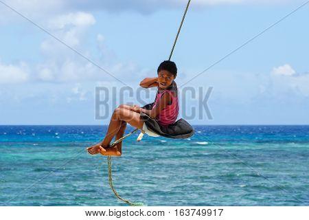 Lavena, Fiji - November 27: Unidentified Girl Swings On A Rope Swing On November 27, 2013 In Lavena