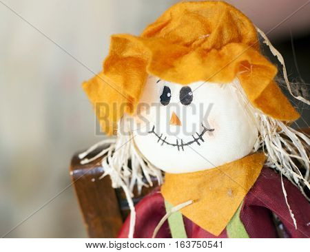 Brightly colored scarecrow clothed in orange and red