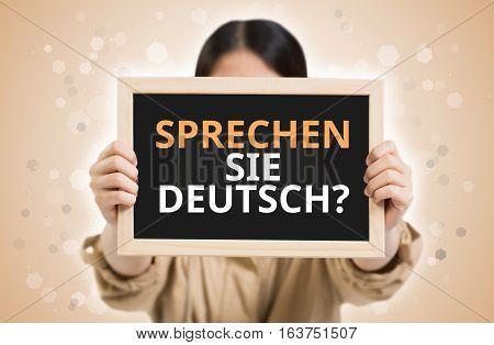 Do You Speak German? (in German) Text On Chalkboard In Child Hands.